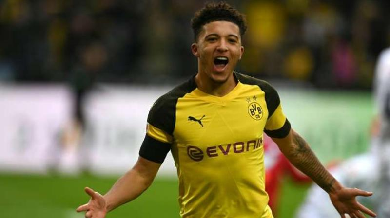 Borussia Dotmund's Jadon Sancho was pictured joking with a supporter who implored him to sign for Manchester United as the winger prepared for England's final Euro 2020 qualifier in Kosovo on Sunday. (Photo:AFP)