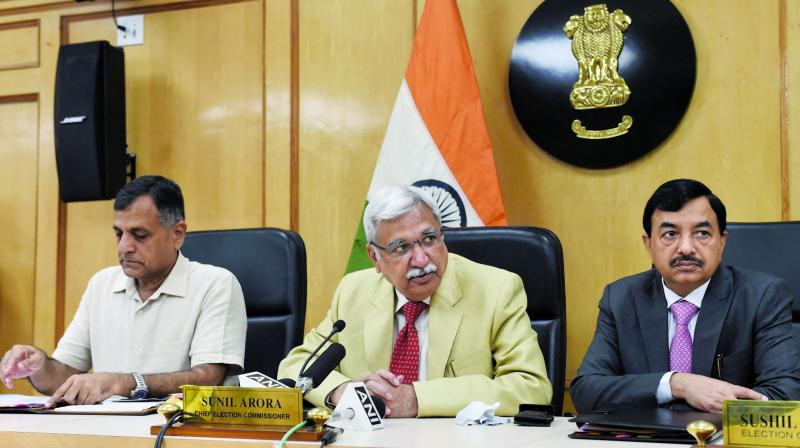 Chief Election Commissioner Sunil Arora flanked by Election Commissioners Ashok Lavasa (L) and Sunil Chandra during a press conference regarding Maharashtra and Haryana Assembly Elections, at Election Commission in New Delhi on Saturday. (Photo: PTI)