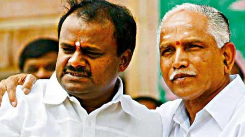A file photo of B.S. Yeddyurappa with H.D. Kumaraswam