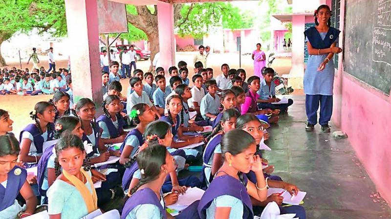 Thirteen-year-old K. Srija teaching other school children.
