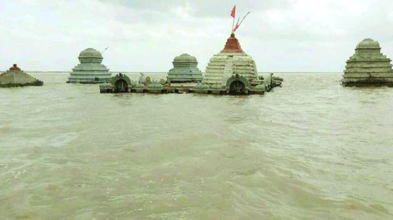 Sri Lalitha Sangameshwara temple submerged in the backwaters of Srisailam project on Monday.