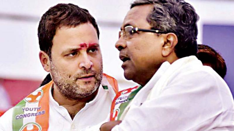 A file photo of former CM Siddaramaiah with Congress chief Rahul Gandhi.