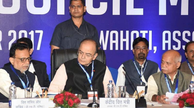 Union finance minister Arun Jaitley along with MoS for finance Shiv Pratap Shukla and finance secretary Hasmukh Adhia (left) at the 23rd GST Council Meeting, in Guwahati on Friday. (Photo: PTI)