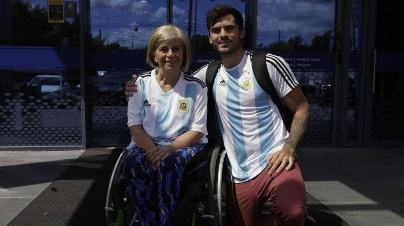 The Argentine fan of Lionel Messi, Nora Espector, who needs a wheelchair because she has multiple sclerosis, travelled to the World Cup in Russia with her youngest son. (Photo: AP)