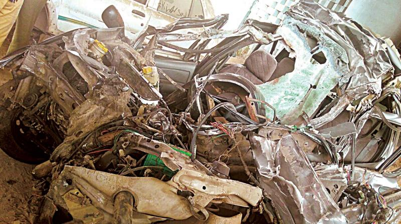 The mangled remains of the car in which the two techies were travelling, when their car rammed into a truck from behind