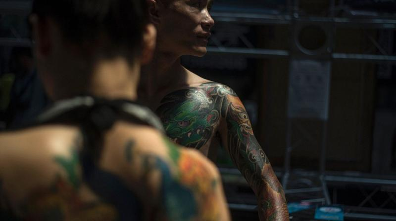 592c0afaca7eb One in five adults in the UK now have tattoos (Photo: AFP)