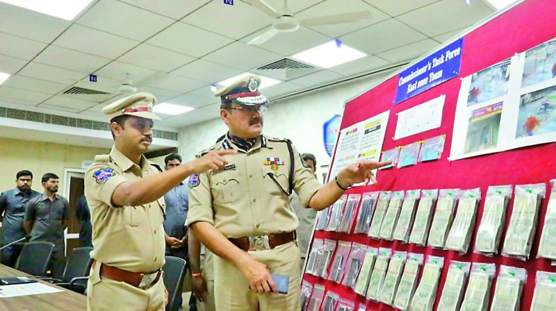 Hyderabad police commissioner Anjani Kumar, task force additional DCP S. Chaitanya Kumar inspect documents recovered from accused Srinivas Rao. (Photo: DC)