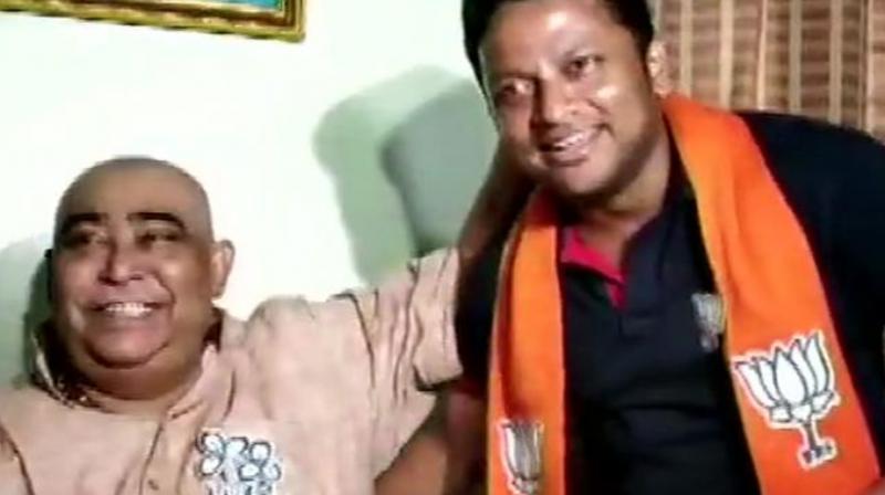 JP candidate from Jadavpur, Anupam Hazra met TMC's Birbhum district president Anubrata Mondal, on Monday in Birbhum's Bolpur.(Photo: ANI)