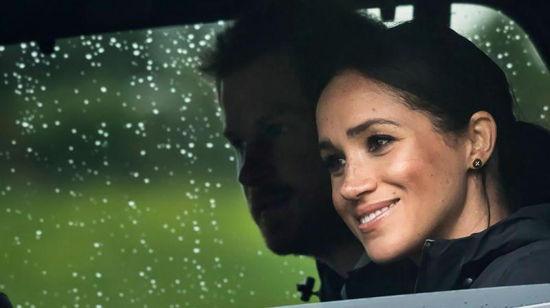 Britain's Prince Harry and his wife Meghan, Duchess of Sussex arrive for the unveiling of a plaque dedicating 20 hectares of native bush to the Queen's Commonwealth Canopy project at The North Shore Riding Club in Auckland on October 30, 2018. (Photo: AFP)
