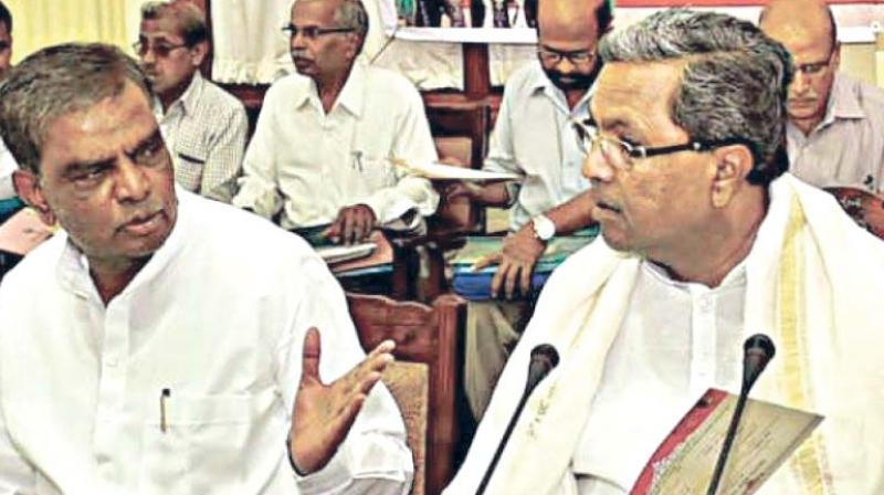 A file photo of V. Srinivasprasad with Chief Minister Siddaramaiah