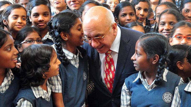 Virendra Sharma, U.K. MP, interacts with schoolchildren in Bengaluru on Thursday.