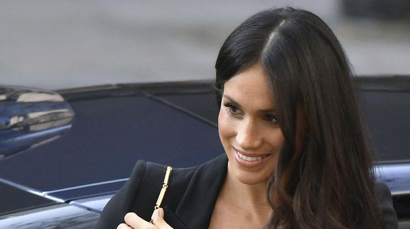 Meghan Markle arrives at the Australian High Commission in London with Britain's Prince Harry to attend a reception celebrating the forthcoming Invictus Games Sydney 2018, Saturday April 21, 2018. (Photo: AP)