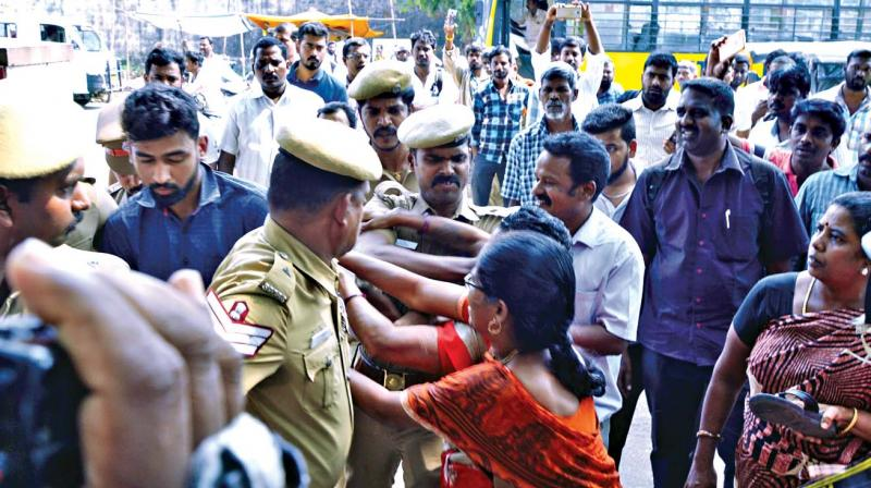 Police personnel ward off women who attempted to attack Dhashwanth on Chengelpet court premises on Wednesday (Photo: DC)