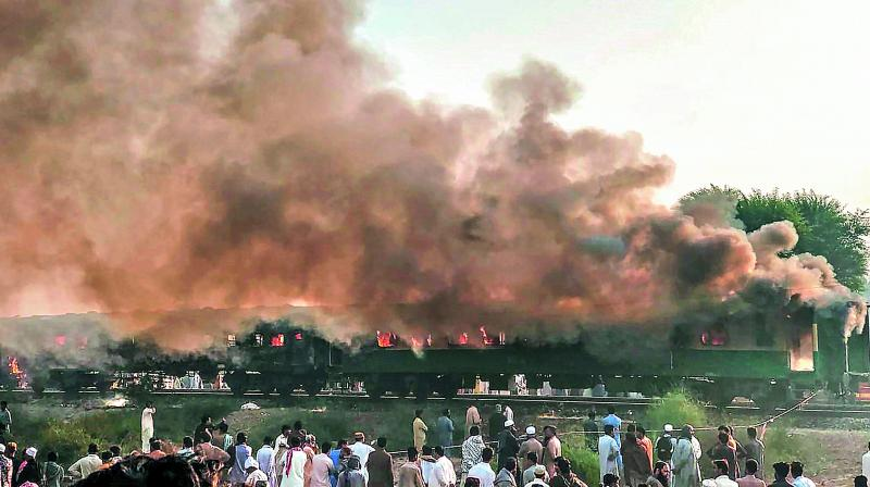 Seventy-three passengers lost their lives and over 40 sustained critical burn wounds on Thursday when three carriages of Tezgam Express caught fire due to explosion in gas canisters purportedly used by Tableeghi Jamaat (preaching party) passengers to cook breakfast near Talwari Station in Liaquatpur area of Pakistan's Rahim Yar Khan city. The train was bound from Karachi to Rawalpindi. (Photo: AFP)