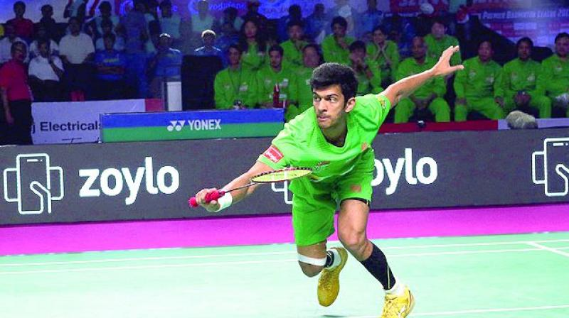 North Eastern Warriors' Ajay Jayaram in action against Delhi Dashers' Wing Ki Wong Vincent in Hyderabad.