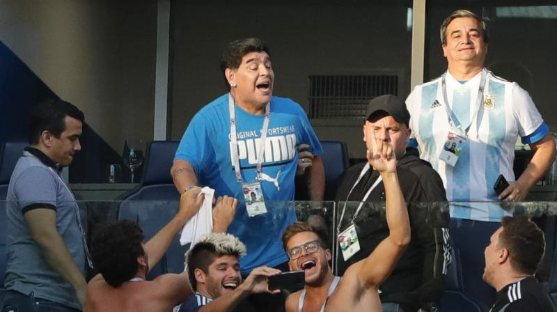 Diego Maradona roared and gesticulated through every anguished second of Argentina's rollercoaster World Cup victory over Nigeria on Tuesday before triggering alarm with a health scare after the final whistle. (Photo: AP)