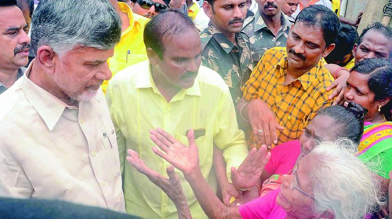 Former chief minister and TD chief interacts with flood-affected in Krishna district on Tuesday.(Photo: DC)