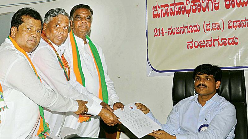 BJP candidate V. Srinivasprasad submits nomination papers for Nanjangud bypoll in the temple town on Monday.