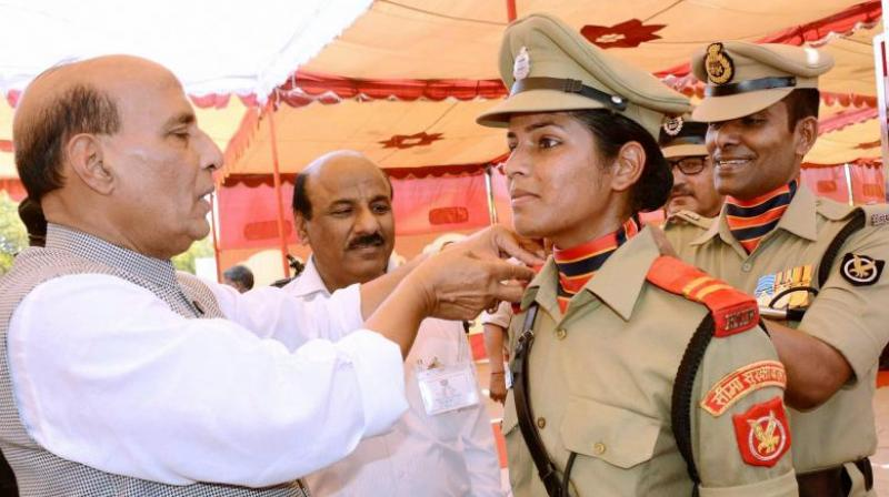 Union Home Minister Rajnath Singh pinning stars on the shoulders of a cadet during passing out parade at Border Security Force (BSF) Academy, Tekanpur, Gwalior. (Photo: PTI)