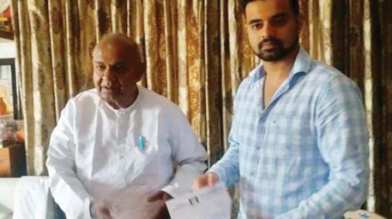 JD(S) supremo H.D. Deve Gowda with his grandson Prajwal Revanna in this file photo