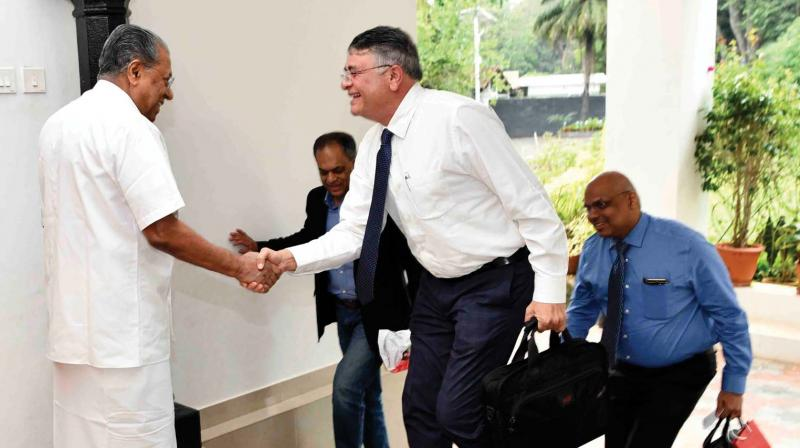 Chief Minister Pinarayi Vijayan comes out of his house to receive Fujitsu Consulting India chief executive officer Shrikant Vaze, senior director Manoj Nair and Nissan chief information officer Tony Thomas at the Cliff House on Thursday. (Photo:PRD)
