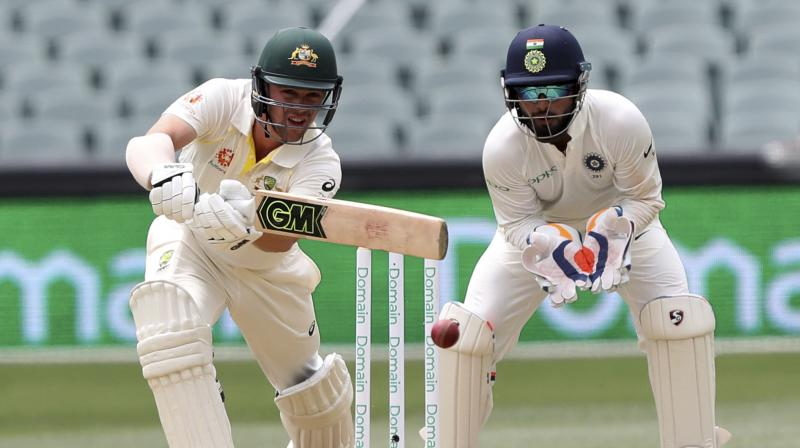 Travis Head remained unbeaten on 61 runs as Australia finished Day two at 191-7, trailing India by 59 runs.(Photo: AP)