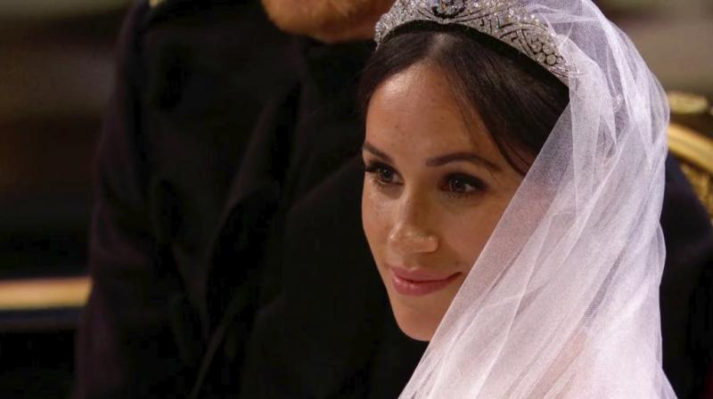 The veil is made from silk tulle with a trim of hand-embroidered flowers in silk threads and organza. (Photo: AP)