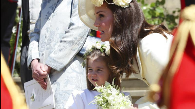 Prince George and Princess Charlotte are adorable in official wedding pictures