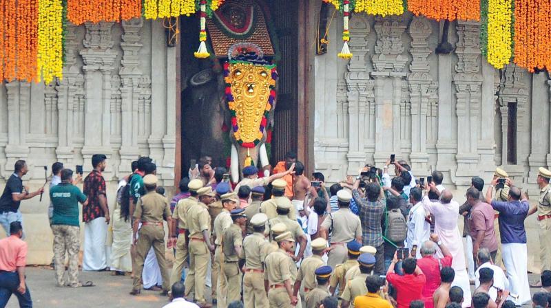 Elephant Thechikottukavu Ramachandran pushes open the southern gopuram of Vadakkumnathan Temple on Sunday morning heralding the Thrissur Pooram.  (ANUP K. VENU)