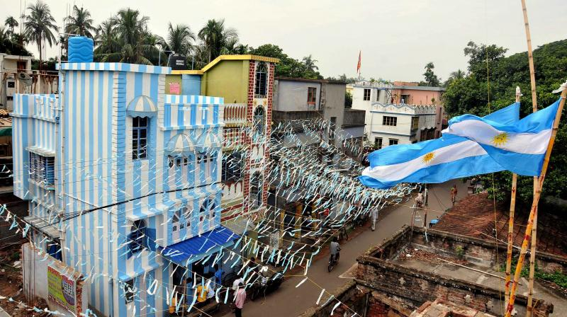 But when a Kolkata-based travel agent informed him that his savings — a princely amount of ₹60,000 — are not enough to fund his World Cup trip, he decided the next best thing — paint his entire three-storey building in Argentina colours. (Photo: PTI)