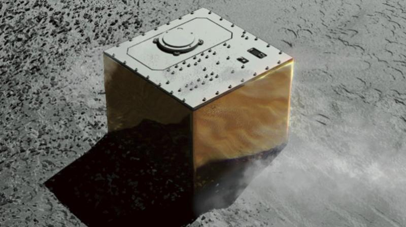 This computer graphic image provided by the Japan Aerospace Exploration Agency (JAXA) shows the Mobile Asteroid Surface Scout, or MASCOT, lander on the asteroid Ryugu. The Japanese unmanned spacecraft Hayabusa2 dropped the German-French observation device, MASCOT, on October 3, 2018, to land on the asteroid as part of a research effort intended to find clues to the origin of the solar system. (JAXA via AP)