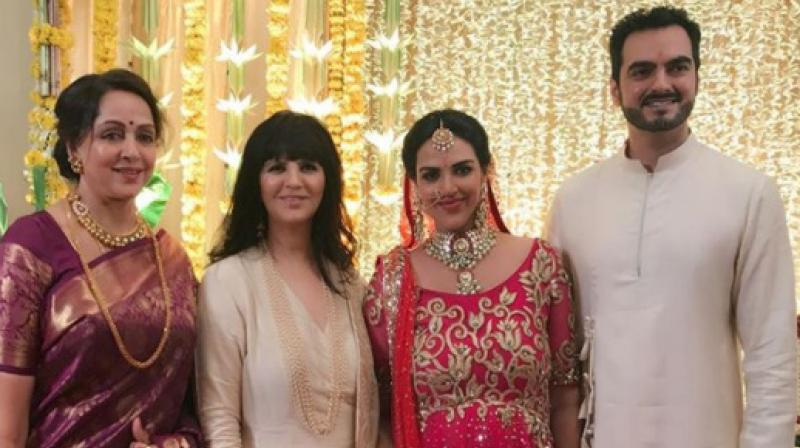 The picture of Esha, her husband Bharat Takhtani and her mother Hema Malini shared on Instagram by Neeta Lulla.
