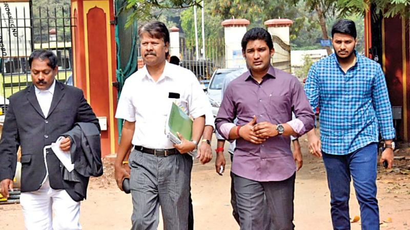 Vivek Jayaraman and his associates appeared before Justice A. Arumughaswamy Commission on Tuesday. (Photo: DC)
