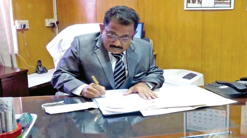 Malick Feroze Khan, TN Election Commissioner.