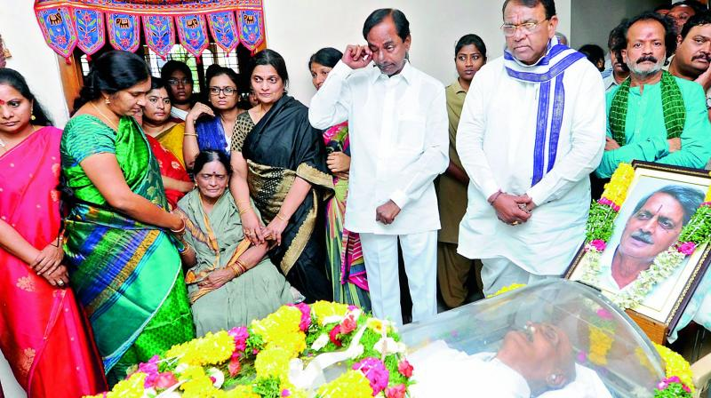 Chief Minister K. Chandrasekhar Rao wipes a tear as he pays his respects to R. Vidyasagar Rao on Saturday.
