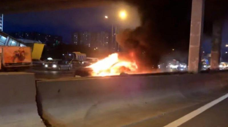 Footage of the incident on state TV channel Rossiya 24 showed the car on fire by the side of the road.