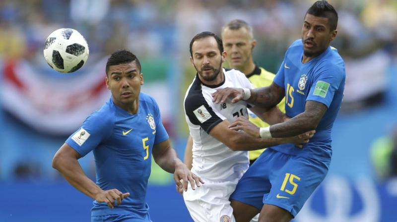 Neymar faced the most devoted of markers in Costa Rica's Cristian Gamboa, the Brazilian spending most of the half hopping over scything tackles or dodging past a barging shoulder. (Photo: AP)