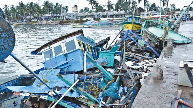 Boats that were damaged due to collision with each other during Gaja cyclone at Adhirampattinam in Thanjavur district. (Photo: DC)