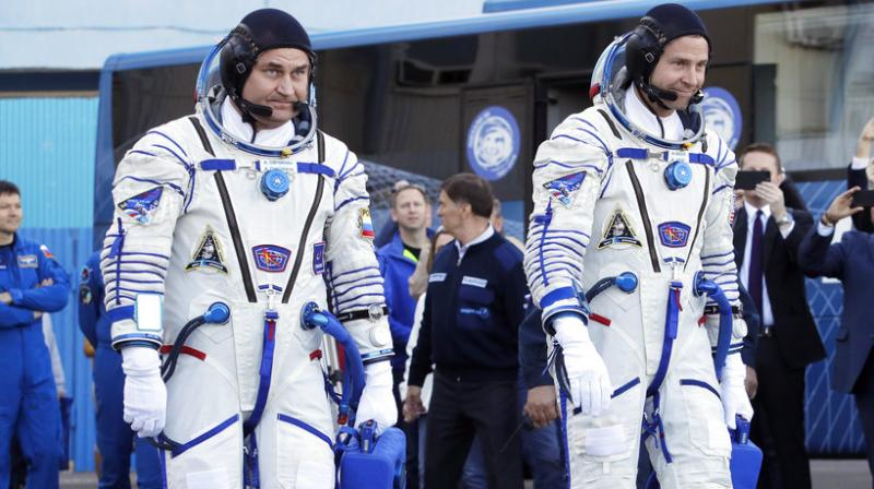 Rogozin on Friday posted a picture on Twitter of himself sat next to the two astronauts and said they had now arrived in Moscow. Both men escaped unscathed and feel fine, Roscosmos has said.
