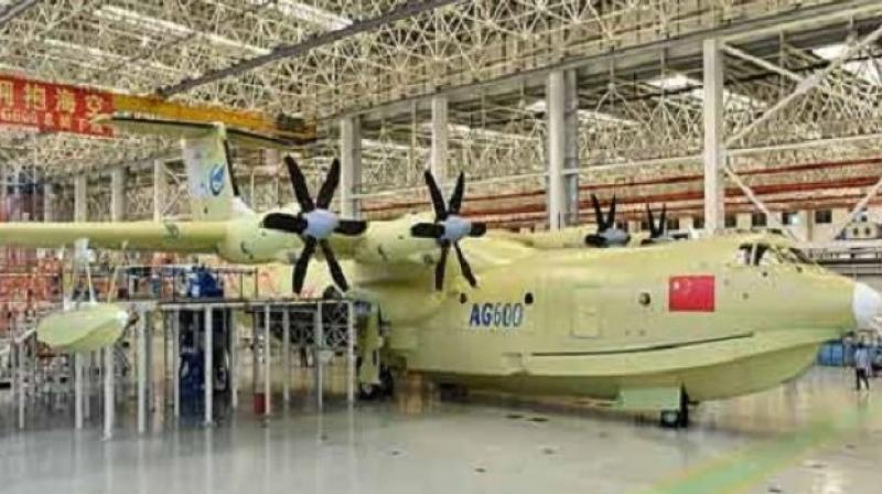 Powered by four turboprop engines, the AG600 can carry 50 people during maritime search-and-rescue missions, and can scoop up 12 metric tons of water within 20 seconds for fire fighting trips, according to state media. (Photo: AFP)