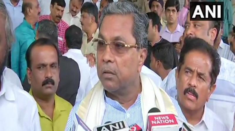 'I do not want to disclose but I am confident that we will win the vote of confidence motion,' former Karnataka CM and Congress leader said referring to Chief Minister H D Kumaraswamy's statement in the House that he was ready to face a floor test. (Photo: ANI)