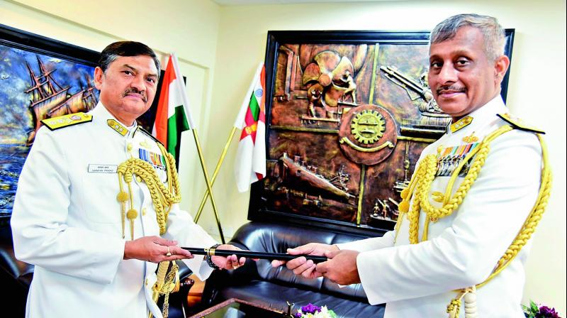 Rear Admiral Amit Bose (right) assumes charge from Narayan Prasad (left) in Vizag on Friday. (Photo: DC)