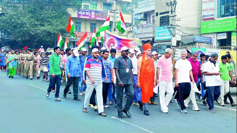 Students and staff of (VVIT) take part in the Dargah to Durga 33-kilometre National Integration walk at Guntur city on Friday. (Photo: DC)
