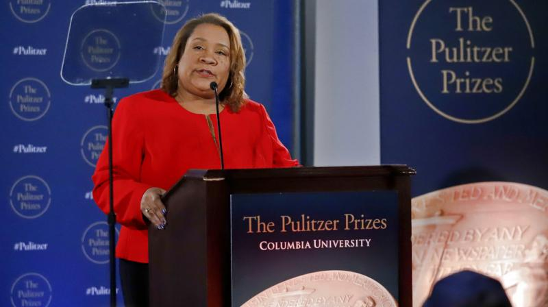Dana Canedy, the new administrator of The Pulitzer Prizes, announces the 2018 winners, Monday April 16, 2018, at Columbia University in New York. (Photo: AP)