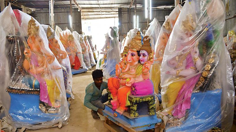 Ganesha idols kept for sale for the upcoming Ganesh Chathurthi Fesitival at RV Road in Bengaluru on Thursday.  (DC)