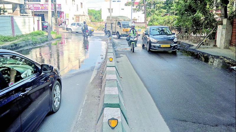 Inconsistent laying of roads results in sewage overflow causing inconvenience to users at Nectar Gardens, near Madhapur.