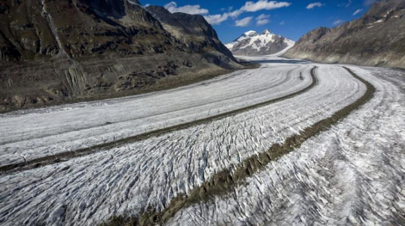 The result, it said, was that the thick snow layer quickly disappeared and the strong melt continued until early September. (Photo: AFP)