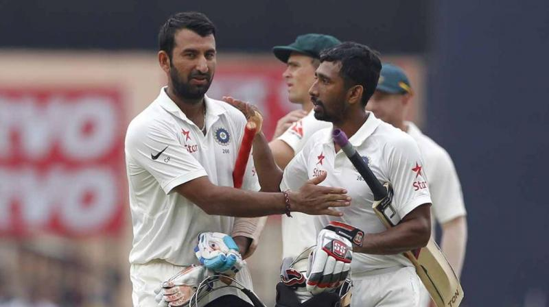 Cheteshwar Pujara (202) and Wriddhiman Saha (117) steered India to 603 for nine against Australia and gave the team a substantial 152-run lead. (Photo: BCCI)