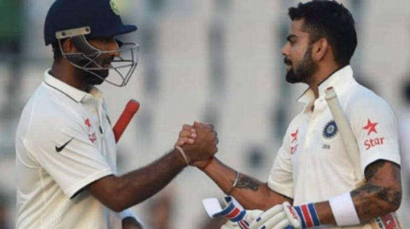 """""""You know what a valuable player he (Cheteshwar Pujara) is for us. He is the most composed player we have in the team,"""" said Virat Kohli while praising Pujara. (Photo: AFP)"""