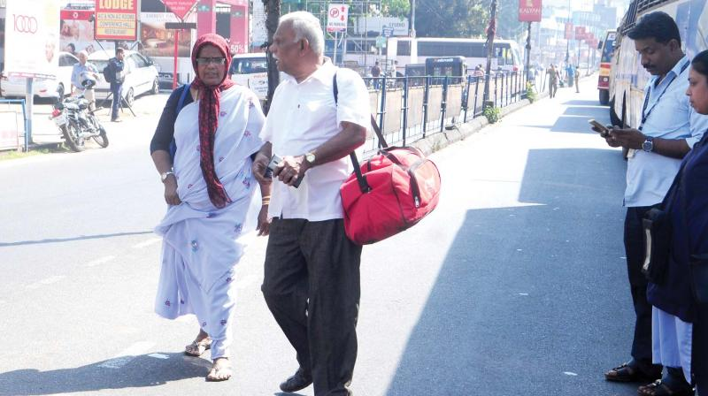 An aged couple trapped on the hartal day in front of the KSRTC bus stand in  Kozhikode on Monday.  (DC)